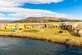 Floating  Islands On Lake Titicaca Puno, Peru, South America, Thatched Home. Dense Root That Plants