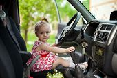 Little Girl In Car