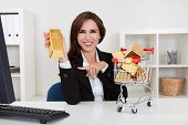 Businesswoman Presenting Gold Bars