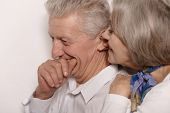 Elderly couple whispering