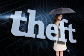 Businesswoman holding umbrella behind the word theft against circuit board