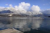 stock photo of annecy  - Panorama of quiet Annecy lake and snowed mountains - JPG