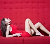 Sensual Young Woman Laying On The Couch