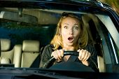 Fright face of  woman driving car and strongly squeeze the wheel