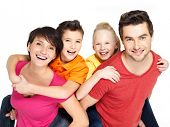 image of cuddle  - Photo of the happy young family with two children isolated on white background - JPG