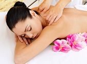 stock photo of pink eyes  - Woman on healthy massage of body in the spa salon - JPG