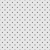Seamless vector pattern, texture or background with small black polka dots on grey background.