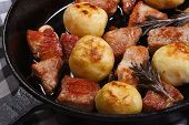 New Potatoes And Roasted Pork With Rosemary In A Pan