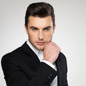 pic of enticing  - Fashion young businessman black suit casual  poses at studio - JPG
