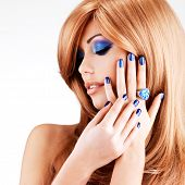 stock photo of fingernail  - portrait of a beautiful woman with blue nails - JPG