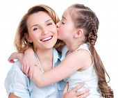young daughter  kissing mother - isolated. Happy family people concept.