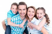 Portrait of the happy european family with children looking at camera -  isolated on white background