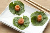 Japanese starter smoked salmon on wasabi leaves