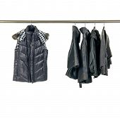 female jacket and coat clothes hanging on clothes rack