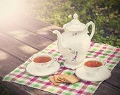 Vintage Picture Of Tea Cups And Teapot On Wooden Table.