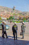 CUZCO, PERU, MAY 1, 2014:  Policemen and policewomen in tactical vests and special equipment control