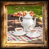 Tea Set In Garden In Wooden Frame.