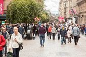 Glasgow, Scotland, UK - 23 August 2014: Lots of people walking on the main street in Glasgow city centre.
