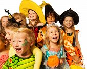 image of little black dress  - Funny wide angle portraits of large group of kids in Halloween costumes laughing and smiling - JPG