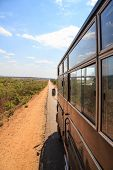 Tourist Bus On A Desolated Road In Africa