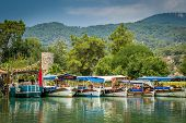 stock photo of dalyan  - Excursion and fishing boats on the Dalyan river - JPG