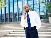 aftrican american businessman in front of office building