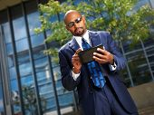 african businessman working on tablet
