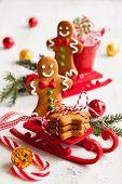 Gingerbread men cookies in a sledge