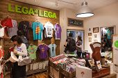 DUBROVNIK, CROATIA - MAY 28, 2014: Tourists in Lega Lega, popular Croatian design store. All of their products are entirely invented, designed and produced in Croatia.