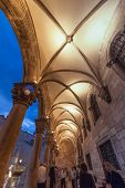 DUBROVNIK, CROATIA - MAY 27, 2014: People in passage way under vaults off Stradun in Dubrovnik, Croatia.