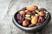 picture of mixed nut  - Trail mix in black bowl - JPG