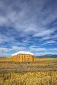 Large Haystack Under Blue Sky.