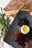 stock photo of qi  - Traditional chinese herbal medicine ingredients with not real hieroglyphs - JPG