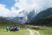 ST-GERVAIS-LES-BAINS, FRANCE - AUGUST 24: Hikers at the Truc Hostel, at bottom of the Domes de Miage