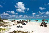 Tropical thatch umbrellas on a beautiful Caribbean beach