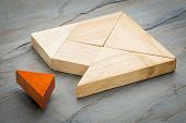 stock photo of tangram  - a missing piece in a square built from tangram shapes - JPG