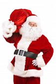 Portrait of a traditional Santa Claus with Christmas gifts. Isolated over white background.