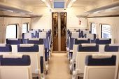 pic of passenger train  - Interior of a passenger train with empty seats - JPG