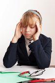 Portrait Of Blond Caucasian Schoolgirl With Headache