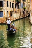 Venice, Italy - Gondolier and historic tenements (filtered)