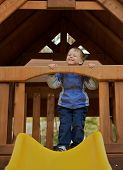 Young toddler on a sliding board