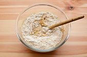 Flour Being Stirred Into Batter For Banana Bread