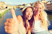 picture of bff  - Girlfriends in city happy giving thumbs up - JPG