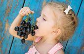 Cute Toddler Girl Eating Grapes