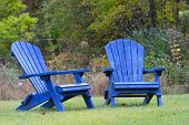 Blue Adirondack Chairs in Autumn outdoor scene