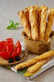 French Stick With Tomato And Olives In Terracotta Dishes