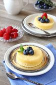 Delicious Lemon Pudding Cake Served With Berries