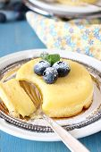 stock photo of custard  - Lemon Sponge Custard cake served with berries on plate - JPG