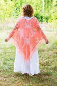 Woman In A Knitted Poncho In Nature