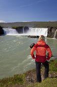 Woman Tourist At Godafoss Waterfall, Iceland